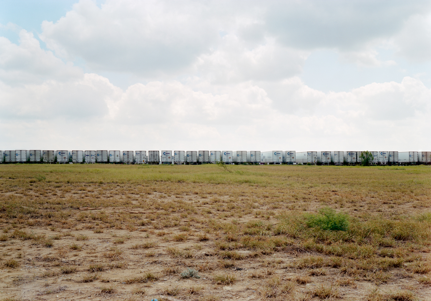 Untitled (Celadon trucks), Laredo, Texas, 2000  © Victoria Sambunaris