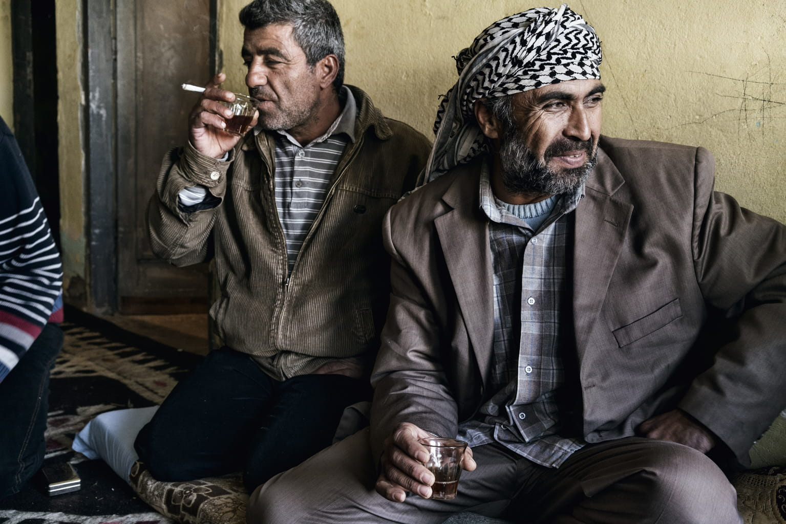 December 8, 2015, Reyhanli, Turkey. Men stop in to drink tea. There is little work in the countryside, especially in winter.