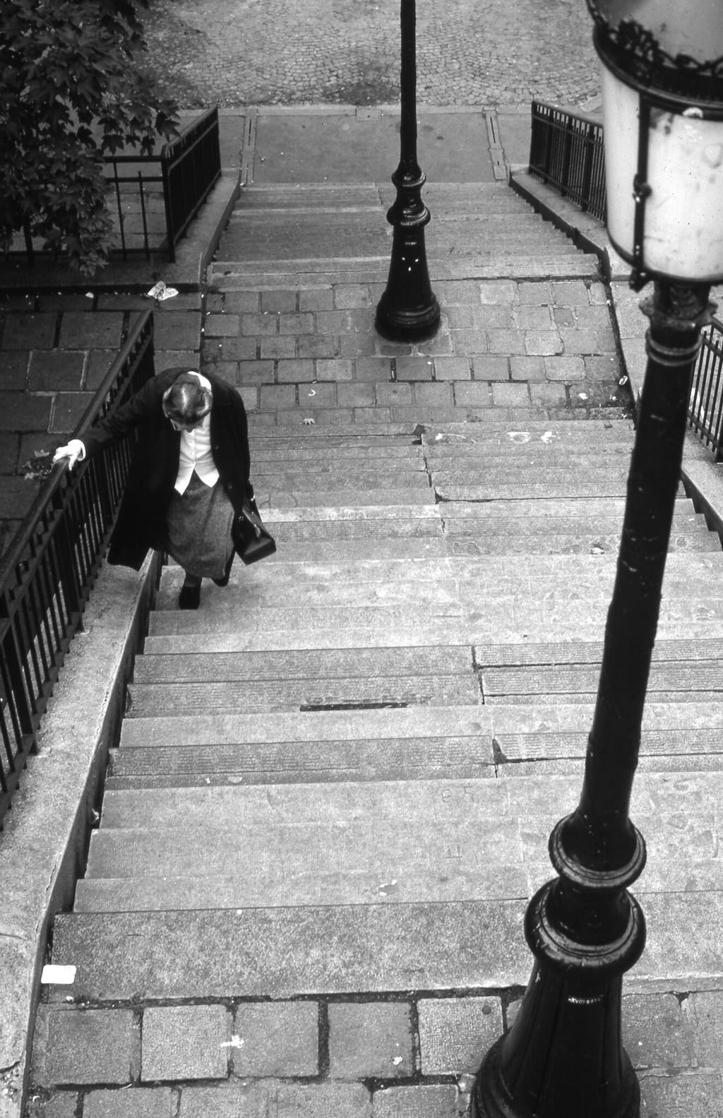 Old woman on steps, Paris