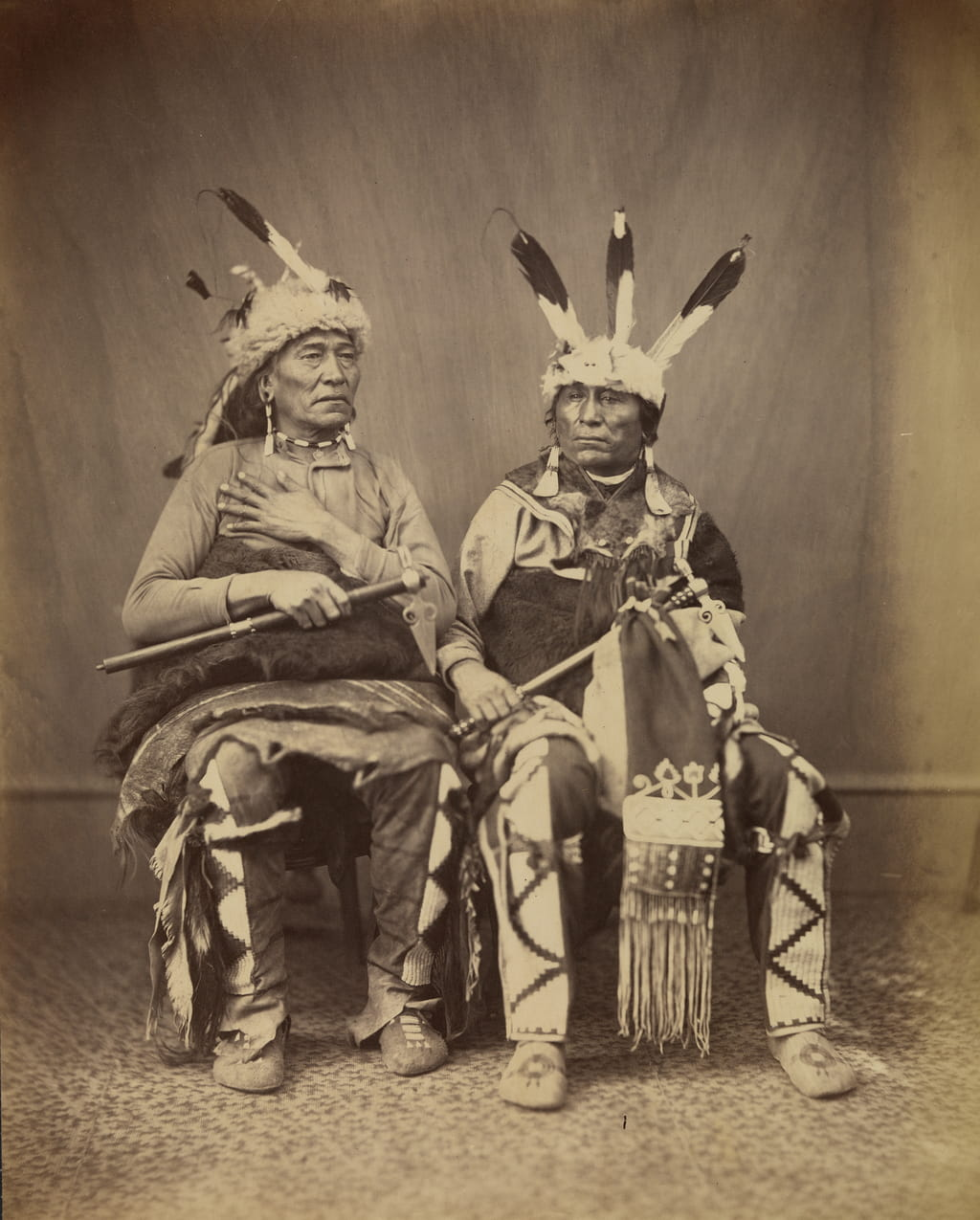 Ihanktonwan Nakota delegates Si-ha-han-ska (Long Foot), left and Wa-jin-ka (Little Bird), right by Alexander Gardner, 1867. (National Museum of the American Indian Archive Center, Smithsonian Institution)