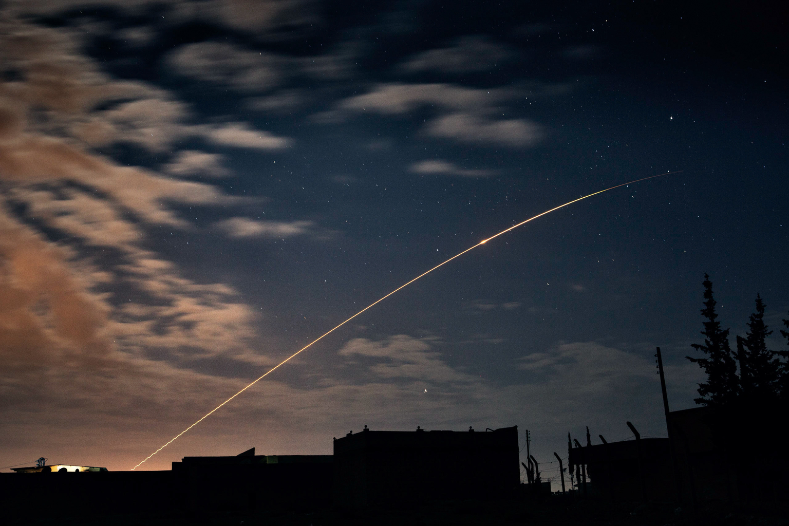 April 18, 2013, Naqqarin, Aleppo. I counted more than fifty rockets fired by Syrian Government forces that night. They arced silently up through the clouds toward the northern countryside of Aleppo.
